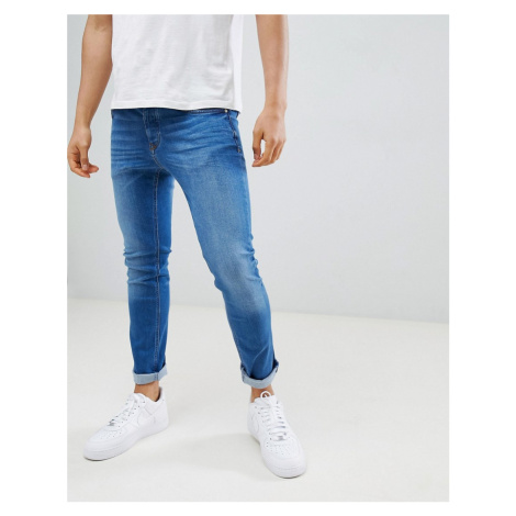 River Island skinny jeans in mid wash blue