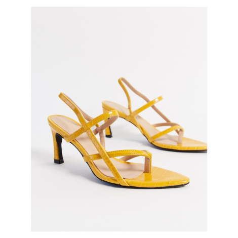 NA-KD pointed sole toe-strap heels in yellow
