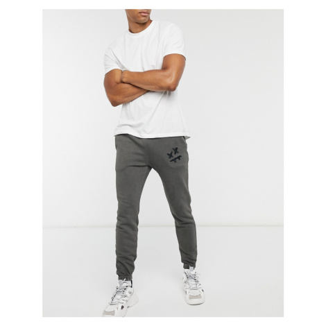 SikSilk x Steve Aoki joggers in grey-Black