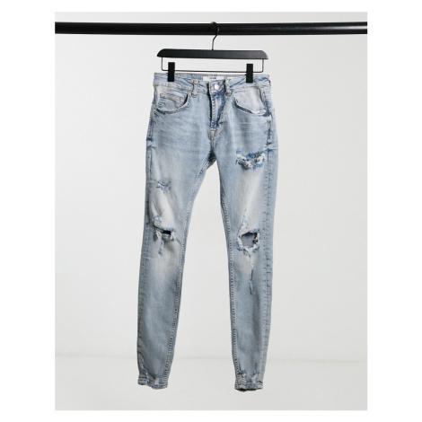 Bershka super skinny acid wash jeans in blue