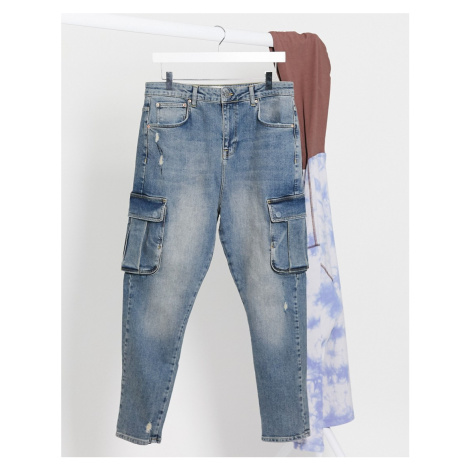ASOS DESIGN drop crotch jeans in dark wash blue tint with cargo pockets and abrasions