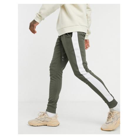 ASOS DESIGN skinny joggers with side stripe in khaki-Green