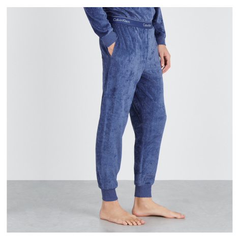 Tmavě modré tepláky Jogger Modern Co. Velour Calvin Klein