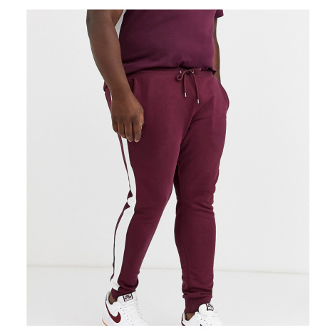 ASOS DESIGN Plus co-ord skinny joggers with side stripe in burgundy-Red