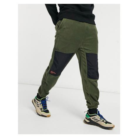 Bershka polar fleece joggers in khaki-Green