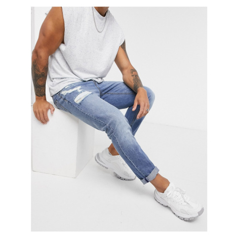 ASOS DESIGN slim jeans in mid wash with abrasions-Blue