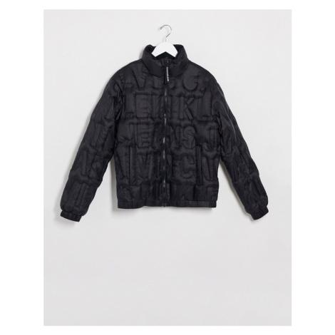 Calvin Klein Jeans embossed logo puffer jacket in black