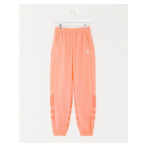 Adidas Originals large trefoil track pant in coral-Orange
