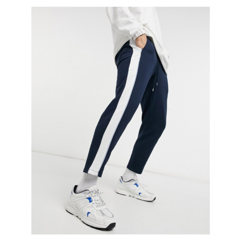 ASOS DESIGN co-ord tapered joggers with fixed hem & side stripe detail-Blue