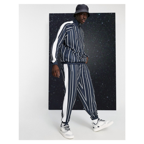 ASOS DESIGN co-ord oversized joggers in pin stripe with side panel in black & white