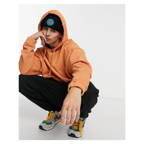 ASOS DESIGN oversized hoodie in washed orange