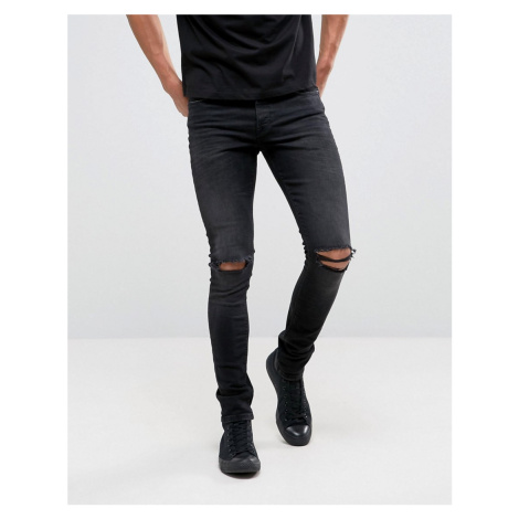 ASOS DESIGN super skinny 12.5oz jeans with knee rips in washed black - Black