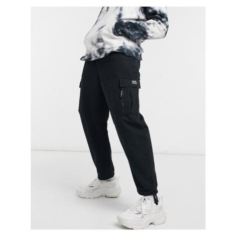 Bershka cuffed cargo trousers in black
